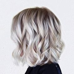 Curled blond bob                                                                                                                                                                                 More