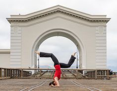 The World Is My Yoga Mat: Karen in Handstand pose at Pier 39, San Francisco, California, USA. Photography by Ben Willmore.