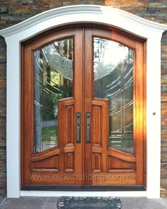 Elegant Entrance- This Arched Top Double Door is perfect statement of elegance. With its unique molding details and classy glass design on the door, you'll be ready to welcome visitors by the masses. go to www.nicksbuilding.com for more info  #elegantentrydoors #exteriordoorswithglass #exteriordoubleentrydoors