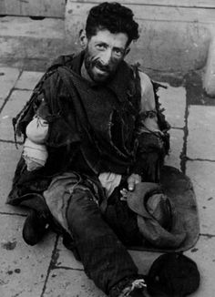 Warsaw, Poland, A beggar sitting in a ghetto street, 1940-1943. Did not survive