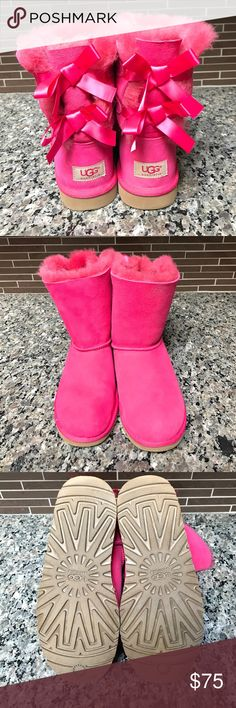 UGG Pink Bailey Bow boots ADORABLE pink Bailey Bow UGGS. **These are a Girls size 5, but fits a Women's size 7** So cute and comfortable and EXTREMELY gently used - only worn 3 times! UGG Shoes Winter & Rain Boots