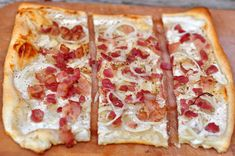 In French, it's known as tarte flambée, in Alsatian it's flammekueche, in German flammkuchen.   Pre-rolled butter puff pastry makes it lighter than the thin crust pizza it is supposed to be made with. Basically, it's a VERY thin crust pizza topped with lardons (bacon strips), white onions and a cream-based sauce made with fromage blanc and crème fraîche.