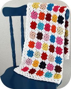 "More granny squares - I like how each one is just one color - makes it a little less ""grandma"" and a little more modern"