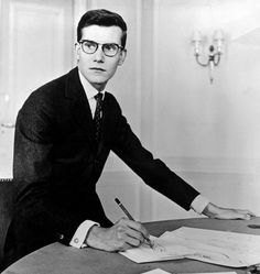 Yves Saint Laurent working on a fashion collection in the 1960's