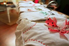 Fun for baby shower. Using scraps of fabric, decorations, ribbon, fabric paint, let guests decorate onesies for baby.