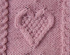 Knitted Hot water Bottle Cover in Hearts Pink Aran Cable
