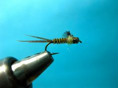 """Barrett demonstrates how to tie a simple but effective Blue Winged Olive nymph. Using UV Ice Dub as the thorax, the fly is given """"hot spot"""" for the fish to key into. Use this pattern all Winter and Spring on the Metolius, McKenzie and Middle Fork of the Willamette. Fish the BWO nymph in tandem with a heavier fly to get in down near the bottom."""