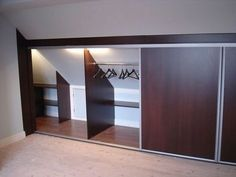 Create a luxury loft bedroom with angled ceiling wardrobes photo - Dachboden Attic Bedroom Ideas Angled Ceilings, Attic Bedroom Storage, Attic Master Bedroom, Attic Bedroom Designs, Loft Storage, Attic Closet, Attic Design, Bedroom Ceiling, Bedroom Wardrobe