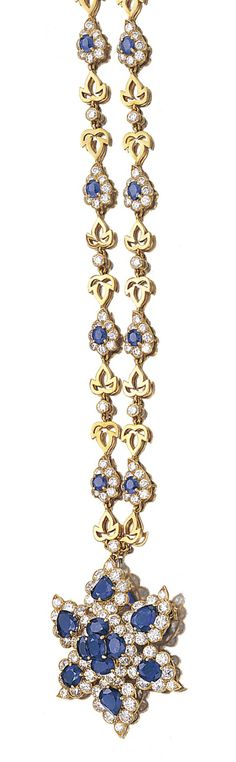 SAPPHIRE AND DIAMOND PENDANT NECKLACE, CARTIER, 1970S.  The necklace designed as a series of brilliant-cut diamond and oval sapphire clusters, alternating with trefoil motifs and bezel-set stones, suspending a removable pendant set with similar and pear-shaped sapphires, mounted in yellow gold, length approximately 420mm, necklace and pendant both signed Cartier London.