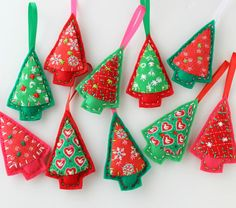 Christmas Tree Shaped Ornaments are handmade from 100% Recycled Eco Friendly Felt, Hand Embroidery, & Vintage Holiday Fabric & hand embroidery from original design & pattern. Ribbon is attached for hanging.