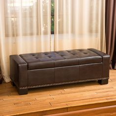 The Luciano ottoman is both comfortable and convenient. Upholstered in tufted brown bonded leather, its storage compartment is a great way to keep spaces clutter free and its padded top is perfect for additional seating or as a coffee table.