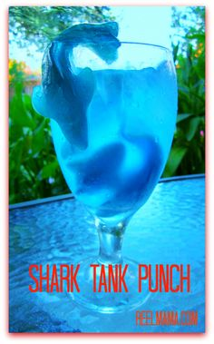 SHARK TANK PUNCH....Fill a glass or clear goblet with store-bought ice, then position several sharks within the ice.  Pour in your favorite lemon lime soda and add a TINY drop of blue food coloring.  Stir just enough to spread the blue food coloring. You may have to reposition the sharks a bit for presentation purposes.  reelmama.com    Read more at http://www.reelmama.com/shark-tank-punch-gummy-shark-drink-kids-will-love/#wf1oDLBlS95F5vEK.99