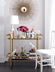 Check us out featured in Style at Home Magazine's High/Low story! Our Pink Ornamental wallpaper is the perfect backdrop for this chic glamorous bar cart. http://www.wallsrepublic.com/pink-damask-wallpaper-p/r2058-parent.htm