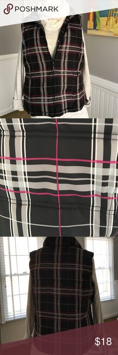Puffer Vest Nice puffer vest , black with a grey and pink plaid design. I lost the tag at my dry cleaners but I know this is size M as most of my clothing, bought at Lord & Taylor. No damages!  EUC Lord & Taylor Jackets & Coats Vests
