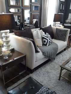 like the neutral colors with dramatic patterns, and the table behind the couch - might work with my set up