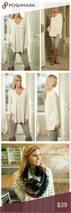 """Gray Striped Tunic I love this top! It's so soft! It's my go to shirt right now. Looks so cute paired with skinny jeans or leggings. Complete the outfit with a cozy infinity scarf. Touch of suede along the V neck. Made in the USA. 95% Rayon 5% Spandex. Size Medium(6/8) Measures approximately 20"""" across bust. 30"""" in length. Large(10/12) Measures approximately 21"""" across bust; 30 1/2"""" in length. Fits pretty true to size. Brand new. Infinity Raine Tops Tunics"""