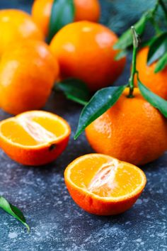 Fresh tangerines with leaves by anjelagr
