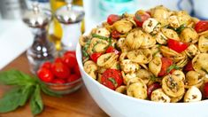 Caprese Pasta 1lb orechiette pasta (round and shaped like a seashell) 1⁄2 cup pesto sauce 3 tbsp balsamic vinegar 1 cup small mozzarella balls 2 cups cherry tomatoes, halved 4-6 basil leaves,