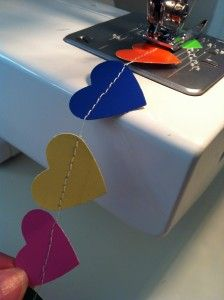 Paint swatch heart garland sewn together - would work with felt shapes, too.
