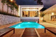 Alberca y Nuevo Bar: Albercas de estilo moderno por Juan Luis Fernández Arquitecto