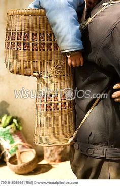 Father Carrying Baby in Traditional Carrying Basket, Hubei, China