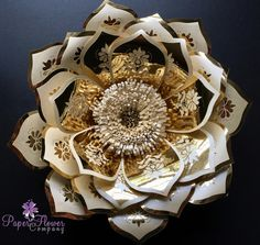 A beautiful paper flower created from pearlescent ivory paper and gold mirror paper for that 'WOW' factor. Stunning on its own or part of a magnificent flower wall. This listing is for one flower created from premium papers and is approximately 30cm (12') in diameter. I can create t