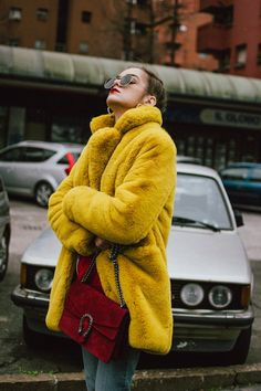 Boohoo yellow faux fur coat, double denim levi's jeans, gucci sneakers, gucci bag, milan, cute winter outfit 2018, andreea birsan, couturezilla, cropped raw hem levi's jeans, raw hem star printed cropped denim jacket, red cashmere sweater, t-shirt, ray ban hexagonal sunglasses, gucci red suede dionysus bag, gucci white and red sneakers, how to wear sneakers in winter, how to wear double denim like a pro, colorful coat, teddy bear coat in yellow, corn braids, heart shaped earrings, how to…