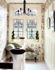 Edwardian house landing-amazing window, like the panelling and the mirrors.