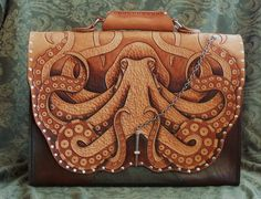 This briefcase is one I recently created from veg tan leather. The octopus is hand tooled and carved , then accentuated with oil dye . The dimensions are and is built to last a lifet. Leather Carving, Leather Art, Tan Leather, Leather Engraving, Leather Skin, Tooled Leather, Leather Tooling Patterns, Leather Pattern, Sculpture Sur Cuir