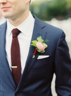 Ranunculus boutonniere: http://www.stylemepretty.com/little-black-book-blog/2015/02/06/elegant-wedding-at-saddle-cycle-club/ | Photography: Kate Ignatowski - http://www.kateignatowski.com/