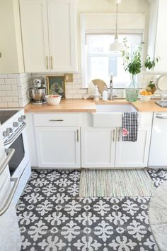 bright white kitchen with intricate tile work and farm sink #kitchen #decor