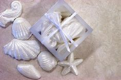 Chocolate Shell Favors In Frosted White Box www.fairytaleweddingshop.com