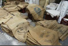I need to go to Paris! Look at the authentic burlap sacks at this french flea market!!!!