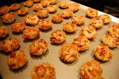 Rotel Cups. These are always a hit at parties! Yum. Pastry cups, Rotel, swiss cheese, mayo, & bacon bits. They disappear instantly!