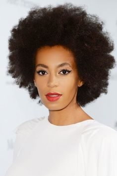 Solange rockin' that natural hair, cat eye, & bold lip.
