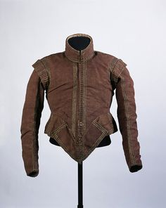 1615-1620 Doublet, Watered wool, trimmed with silk and lined with linen. Whalebone bellypieces.