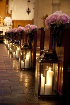 glass lanterns and flower bouquets aisle decor for church wedding, pastel pink flowers decor ideas
