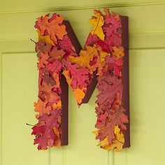 undefinedAlphabet Door Decoration  Create a customized door design for the fall season by using your monogram as the outline for a leaf-covered hanging accent.