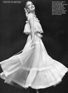 Yves Saint Laurent- 1977 White crepe georgette, bordered with guipure lace, long dress.  L'officiel USA Spring 1977