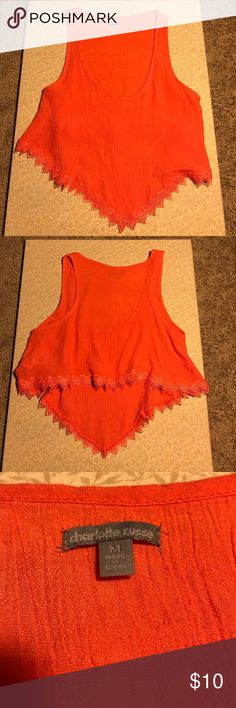 Charlotte Russe Crop Top This orange tank is super cute and it's high low, meaning it's longer in the front than in the back. This shirt would be great with shorts,leggings,jeans,etc. Charlotte Russe Tops Crop Tops