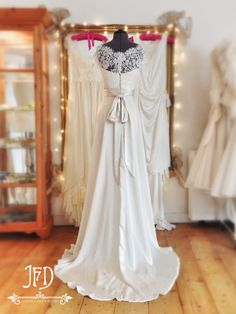 Joanne Fleming Design; Pearl silk chiffon and French lace full length wedding gown