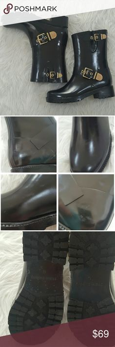 "Vince Camuto 'Hinch' Rubber Rainboots Size 6 NWOT NWOT, No box. Size 6 womens rainboot. Slight scuffing (pictured) from being stored, would probably come off with some polishing. Adorable gold buckles on side. Circumference Measures 13"" Vince Camuto Shoes"