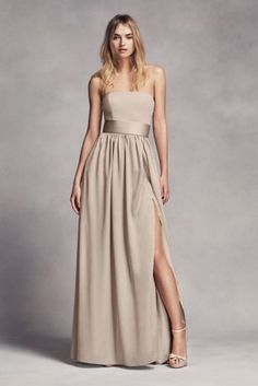 This floor-length crepe and charmeuse bridesmaid dress exudes sophistication with a straight strapless neckline and satin trapunto-stitched belt at the waist. White by Vera Wang, exclusively at Davi