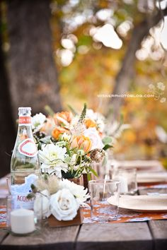 Vintage picnic table wedding reception.  Never thought of forgoing the table clothes, but this is really pretty :-)