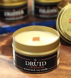 NEW Introducing Druid Wisdom! This mystical, earthy blend was inspired by the power of the elements with subtle verdant top notes and earthy oak wood. Patchouli fans will love this scent, too! Soy Candles, Candle Jars, Nerd Shop, Dnd Classes, Small Tins, Gifts For Bookworms, Container Size, Shop Art, Book Gifts