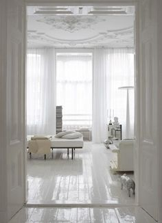 modern take on vintage look! glossy white floor and embellished ceiling with modern furniture--LOVE!