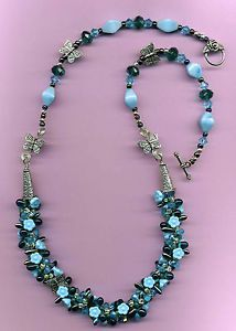 """Kumihimo weave necklace This necklace is hand woven with eight different strands of beads. silvertone metal butterflies,.Silvertone Flower Toggle Clasp 27""""  #Kumihimo  #Jewelrybydevine.com#Wovenjewelry  #Necklace  #Handmadenecklace  #kumihimoweave  #flowernecklace"""