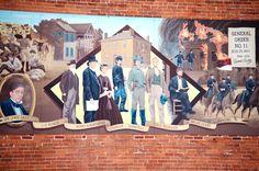 Mural depicting General Order Number 11, Aug. 25, 1863 in Harrisonville, Missouri