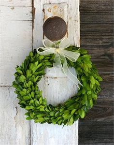 Our Preserved Boxwood Round wreath is handmade using real boxwood which has been preserved to maintain a lush green color and natural texture. This wreath is finished with a sheer ivory bow and ribbon for hanging.