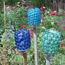 a Garden Treasure Jar made withflat bottom marbles & jars, to give color to the garden